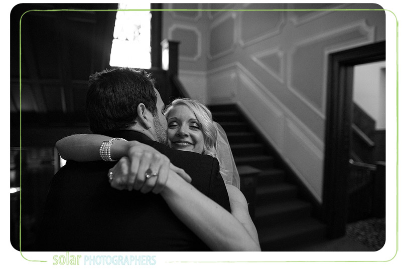 Bride and groom hug after getting married.