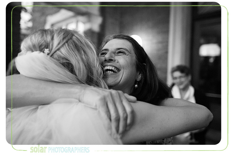 Bride hugs mother in law.