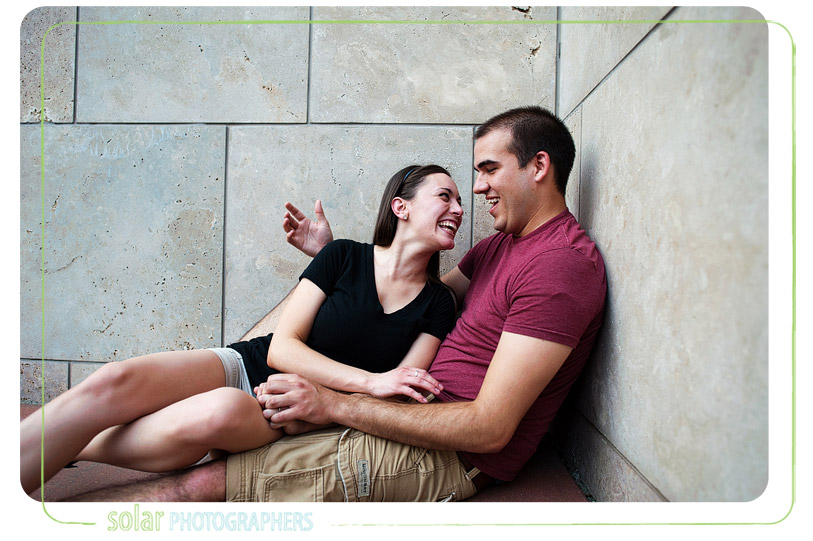 Couple laughing together.