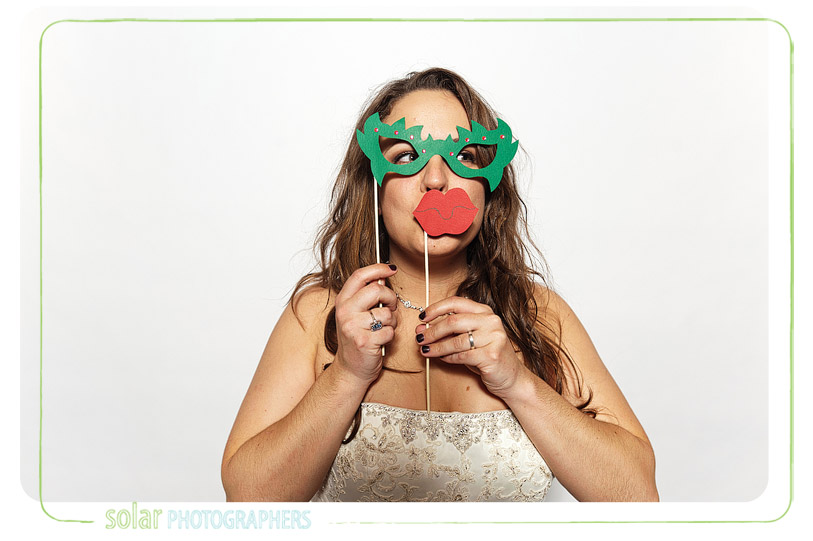 Bride in a sweet photobooth.