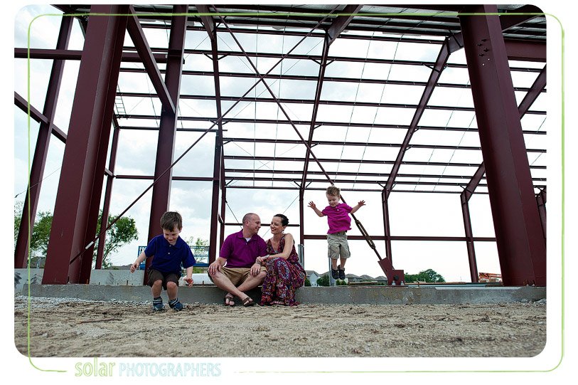 Cute family picture at construction site.