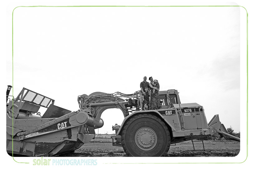 Family portrait on a bulldozer.