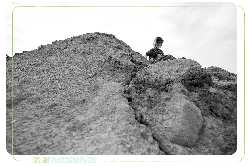 Boy climbing on rocks.