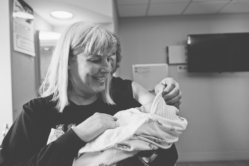 Grandma holding her new grandchild.