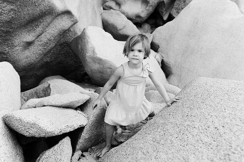 My daughter climbing on rocks at Lover's Beach in Cabo, Mexico.