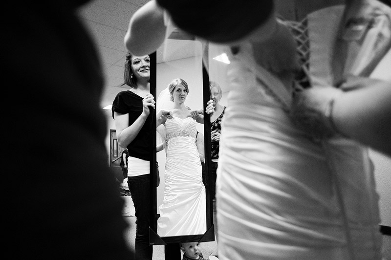 Bride checking herself out in the mirror.