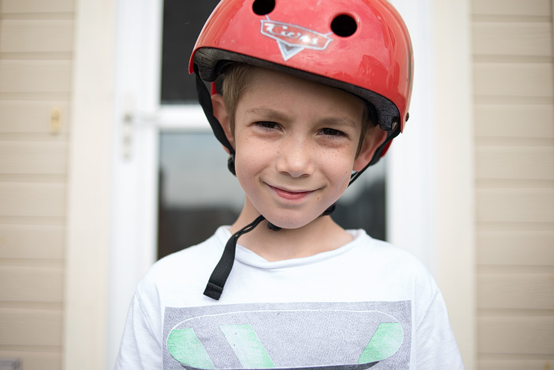 Max wearing his bike helmet after a bike ride.