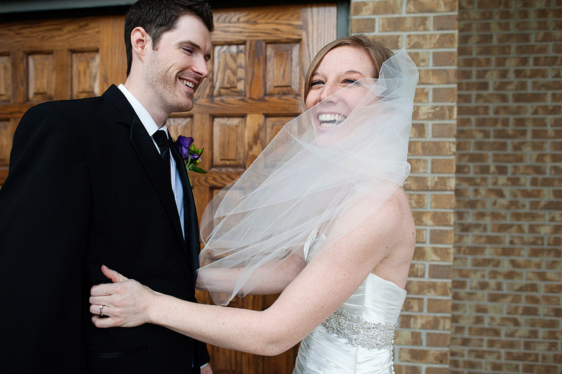 Laughing bride and groom on their wedding day.