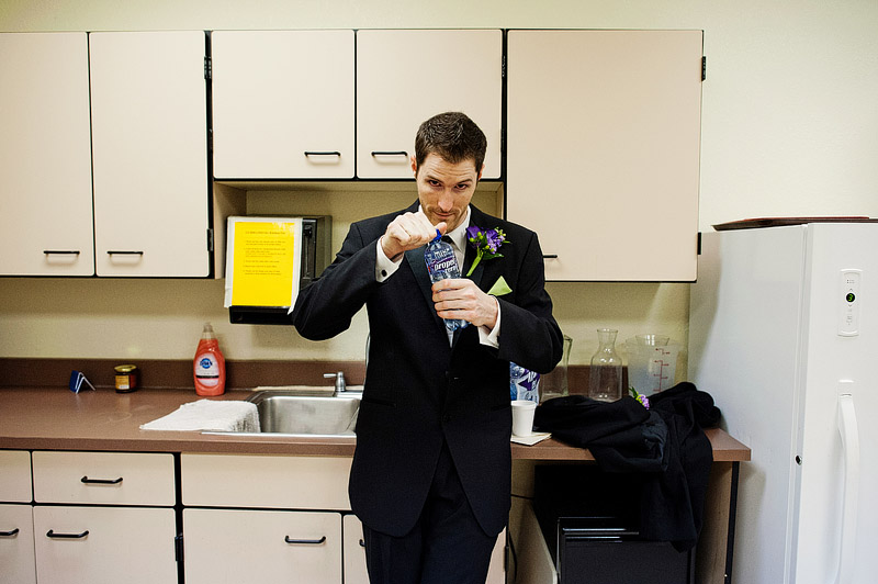 Groom staying hydrated before he gets married.