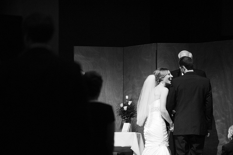 Bride laughing during her wedding ceremony in Kansas City.
