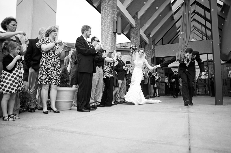 Bride and groom make their exit after their wedding ceremony.