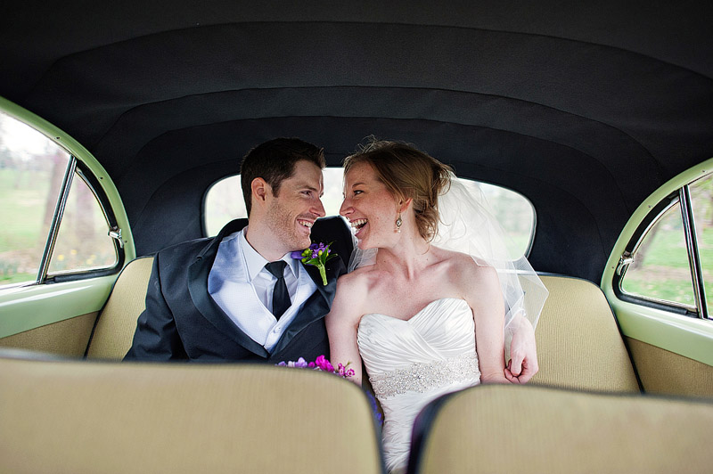 Couple snuggling in a vintage car.