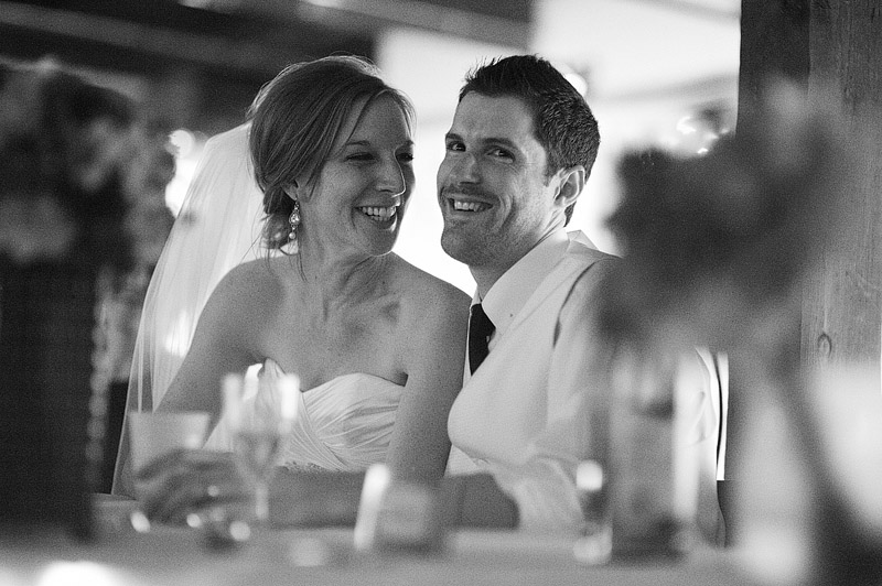 Bride smiles at her husband.