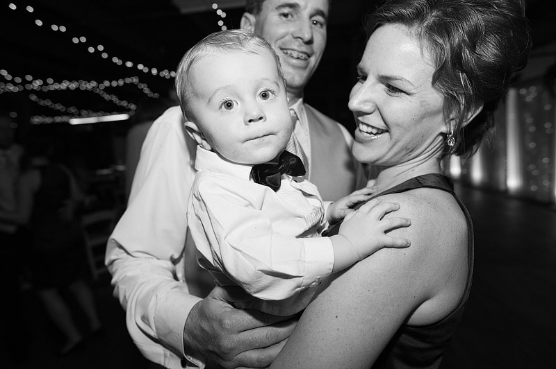 Couple dancing with their baby boy.