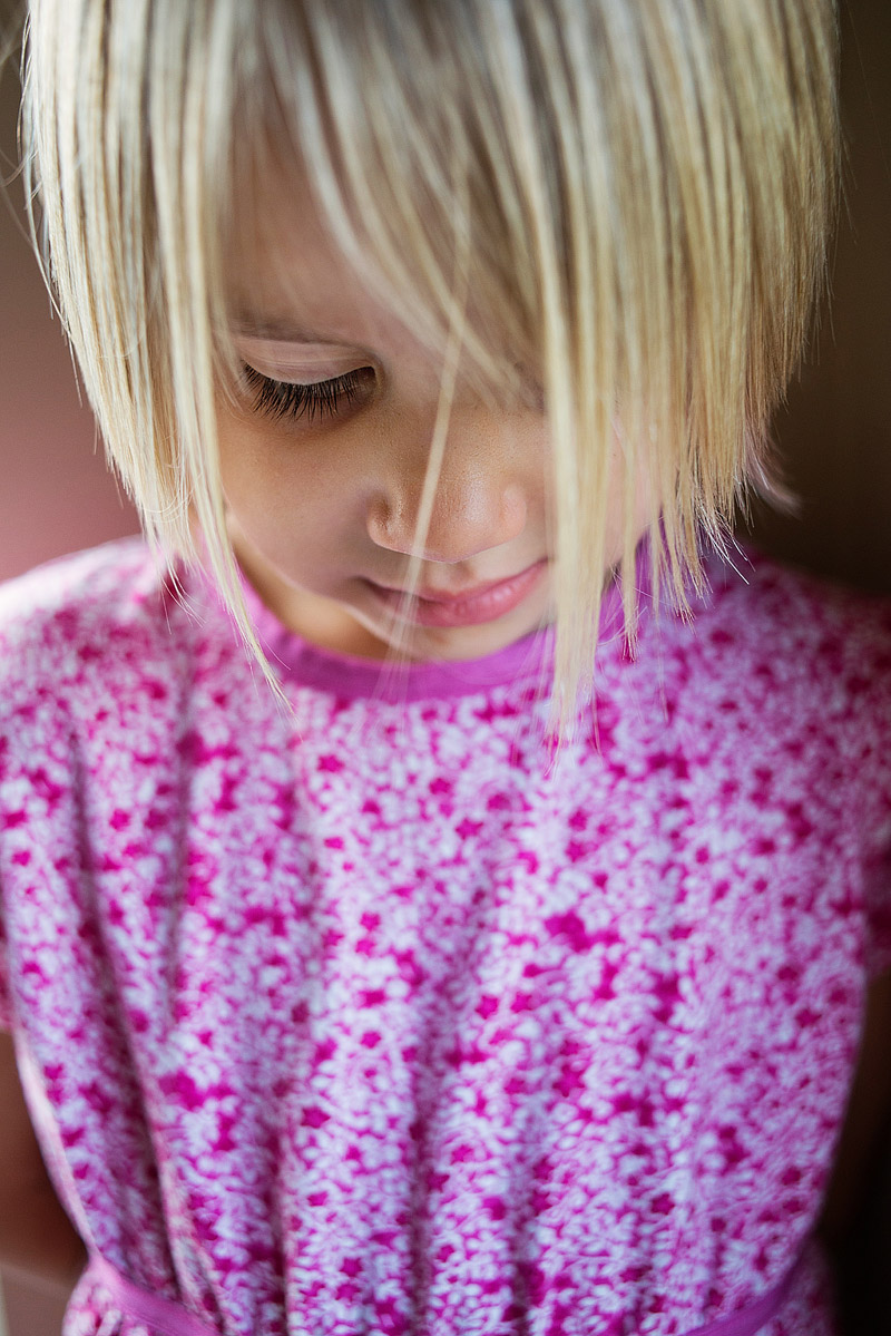 Portrait of a girl looking down.
