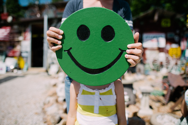 Green smiley face portrait.