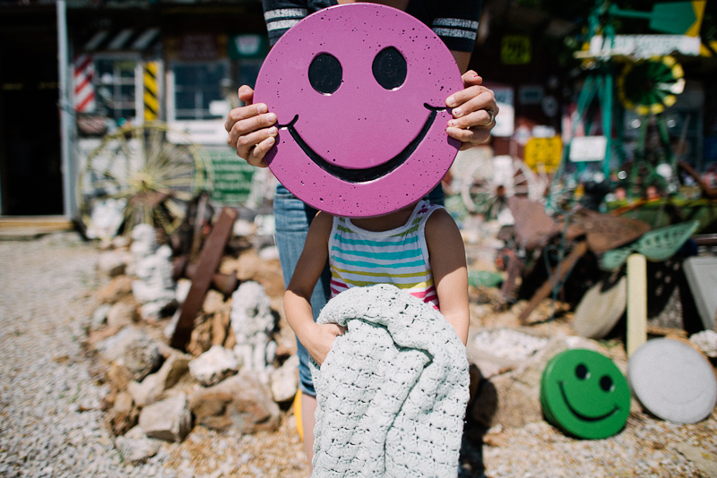 Purple smiley face portrait.