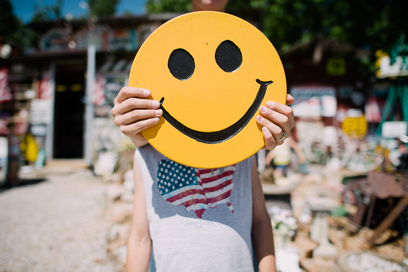 Yellow smiley face portrait.