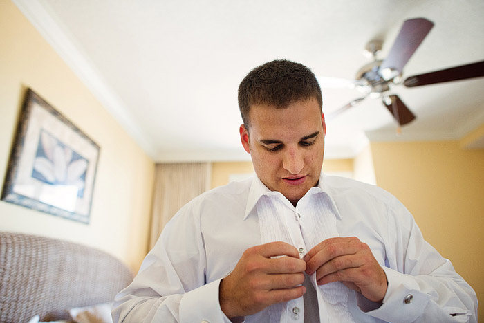 Groom getting ready for his wedding in Destin, Florida.