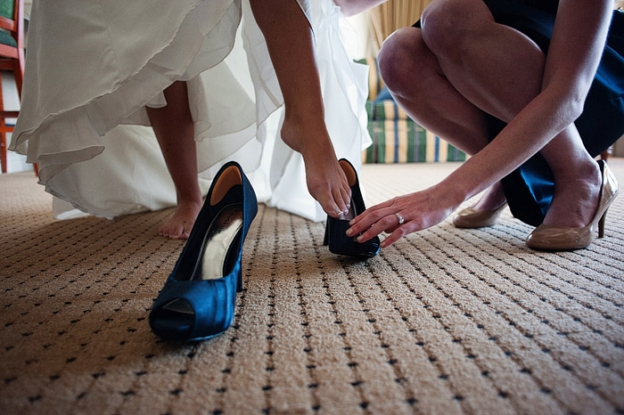 Bride getting her shoes on.