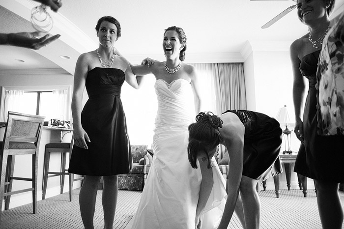 Laughing bride as she gets ready for her wedding in Destin, Florida.