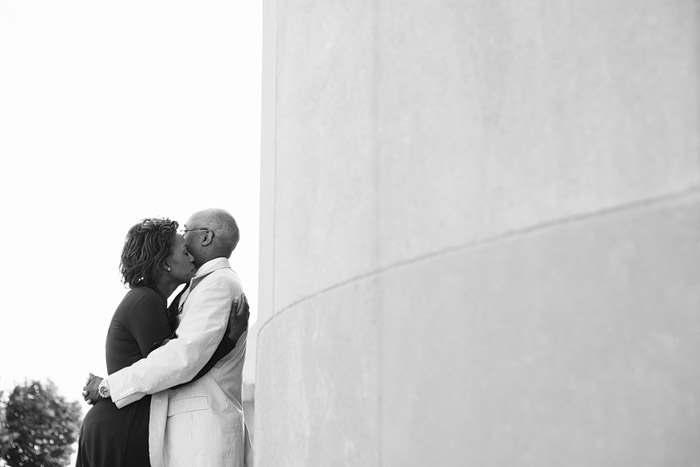 Couple snuggling by Liberty Memorial in Kansas City.