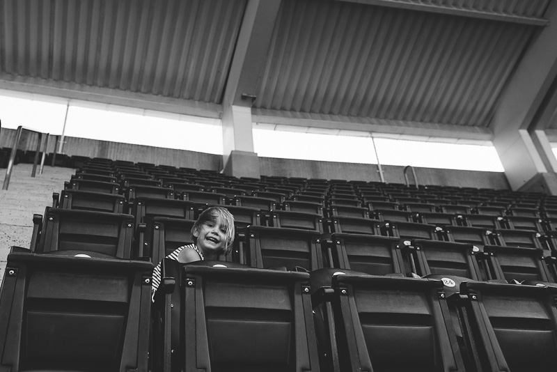 Girl playing in the seasts at Kauffman Stadium in Kansas City.