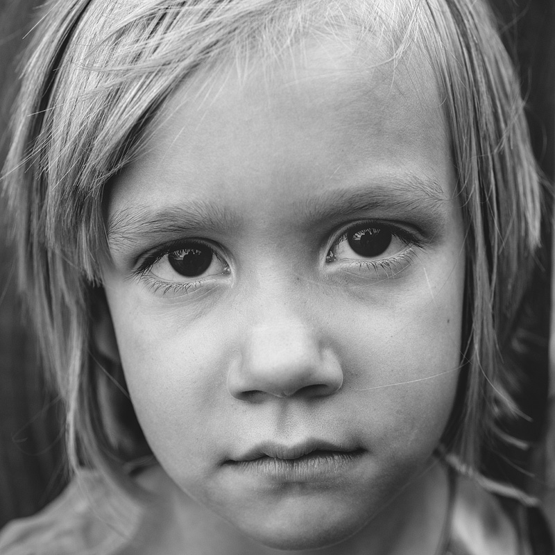 Black and white portrait of a 5 year old girl.