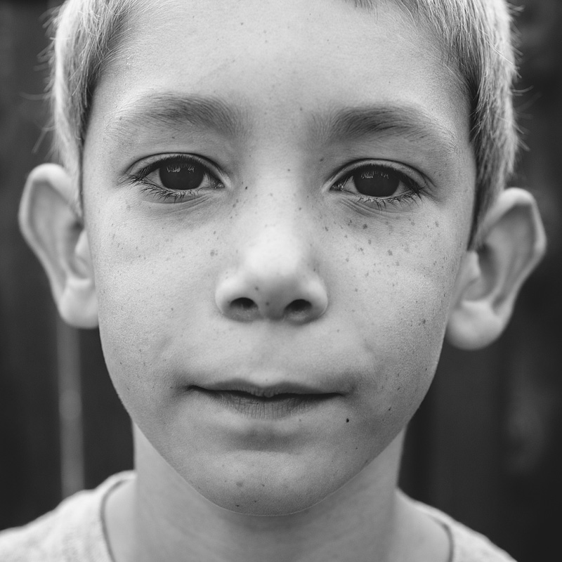 Black and white portrait of a 7 year old boy.