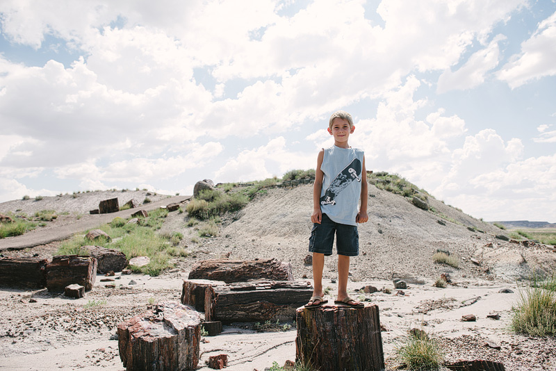 Boy playing in the Petrified Forest of Arizona.