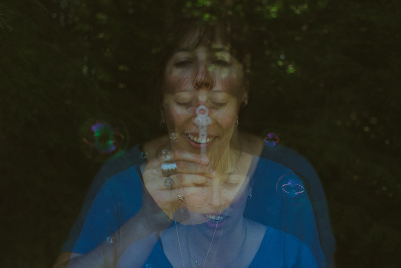 Bubble blowing triple exposure.
