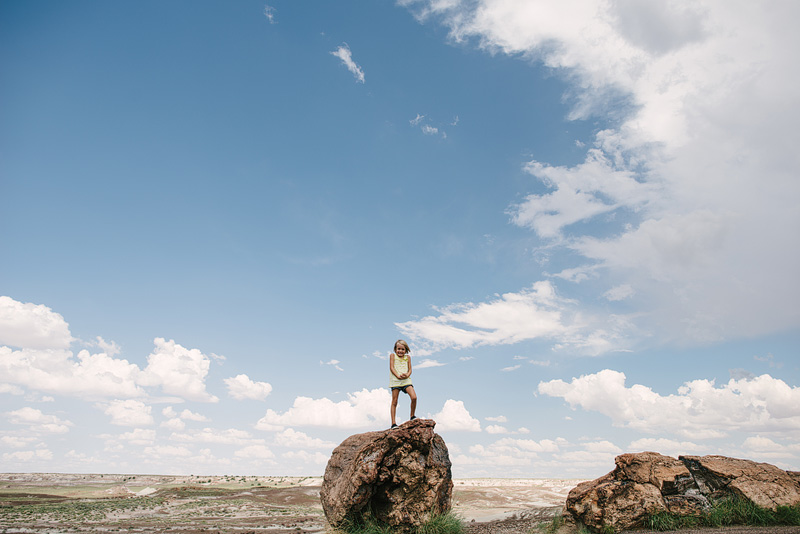 Girl playing in Arizona's Petrified Forest.