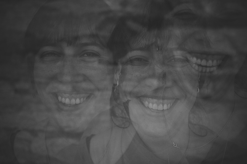 Happy triple exposure of a woman laughing.