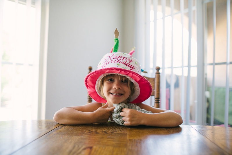 Kid portrait in a birthday hat.