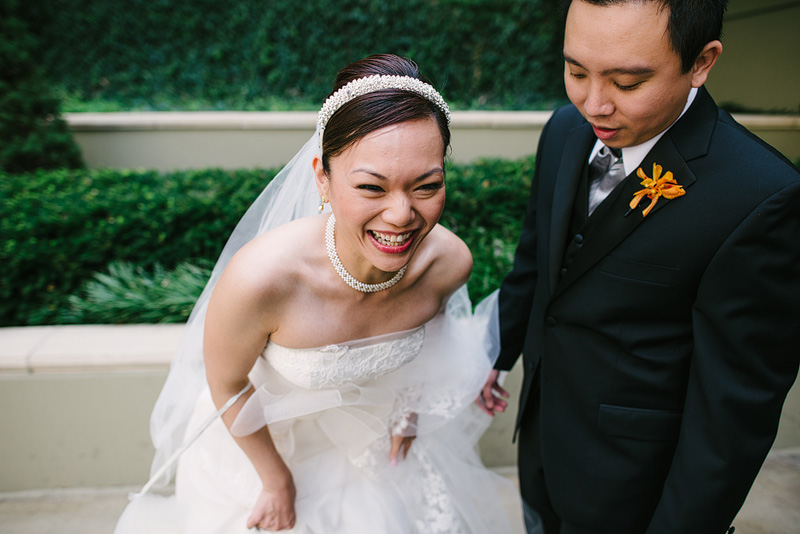 Laughing couple on their wedding day.