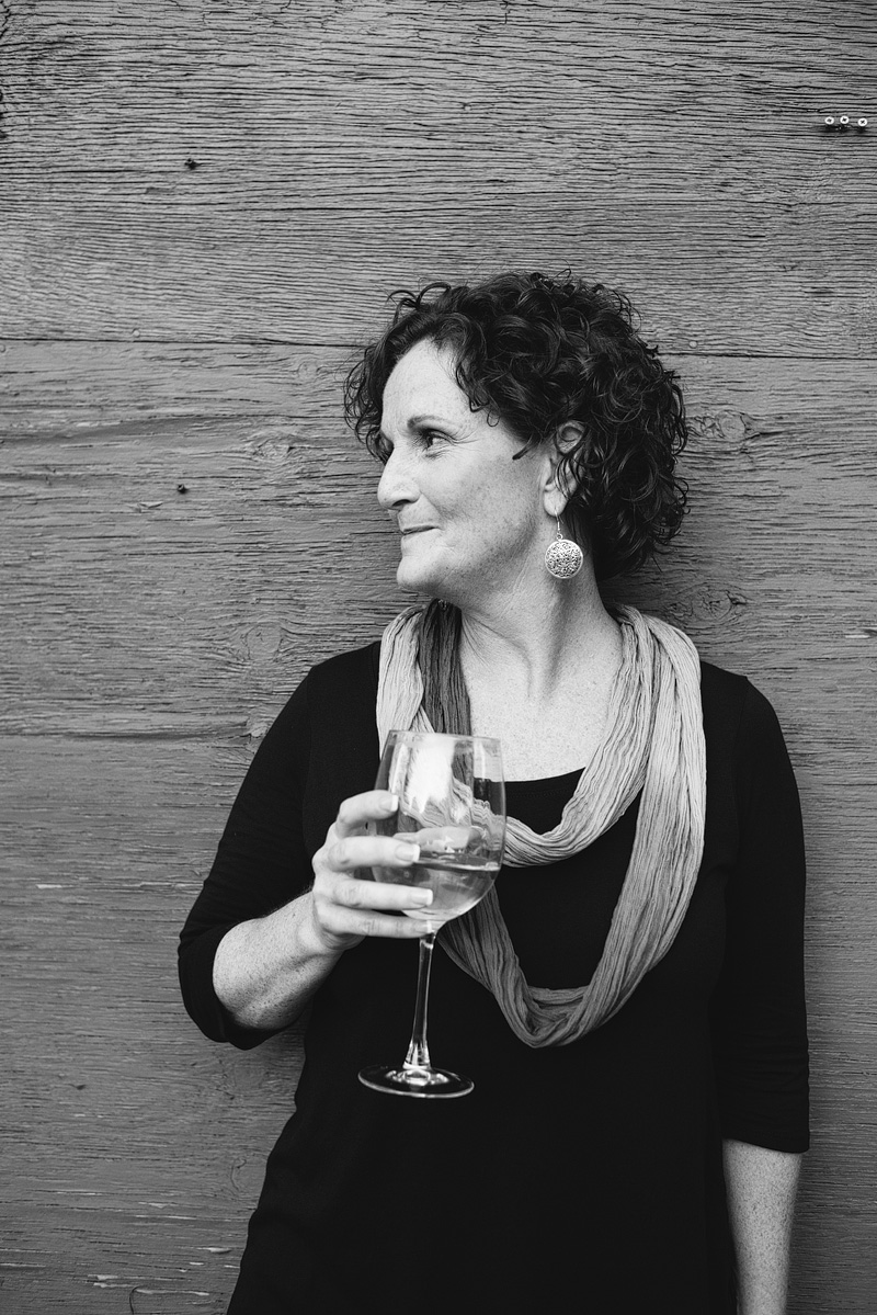Kansas City portrait photography of a woman with wine.