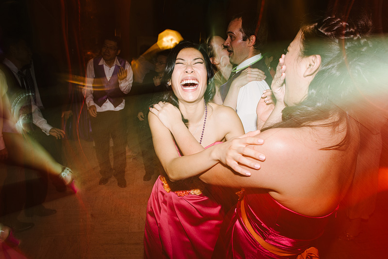 Laughing on the dance floor at a Kansas City wedding reception.