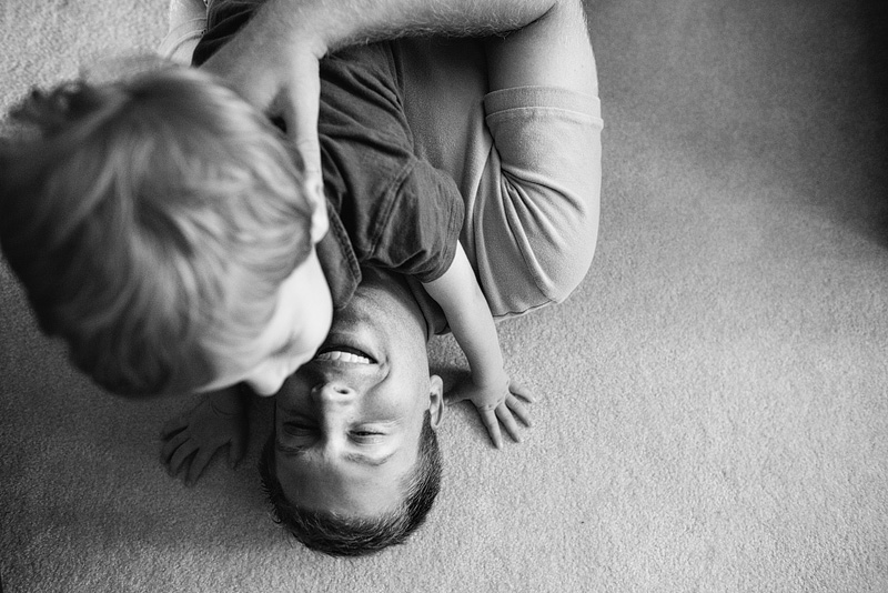 St. Louis portrait photography of a boy playing with dad.