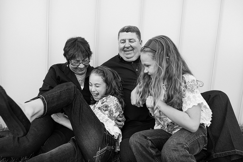 Kansas City portrait photography of family laughing.