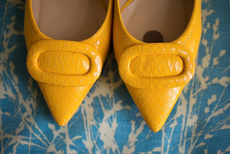 Adorable yellow shoes for a bride.
