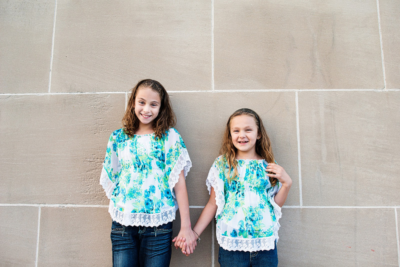 Kansas City portrait photography of girls holding hands.