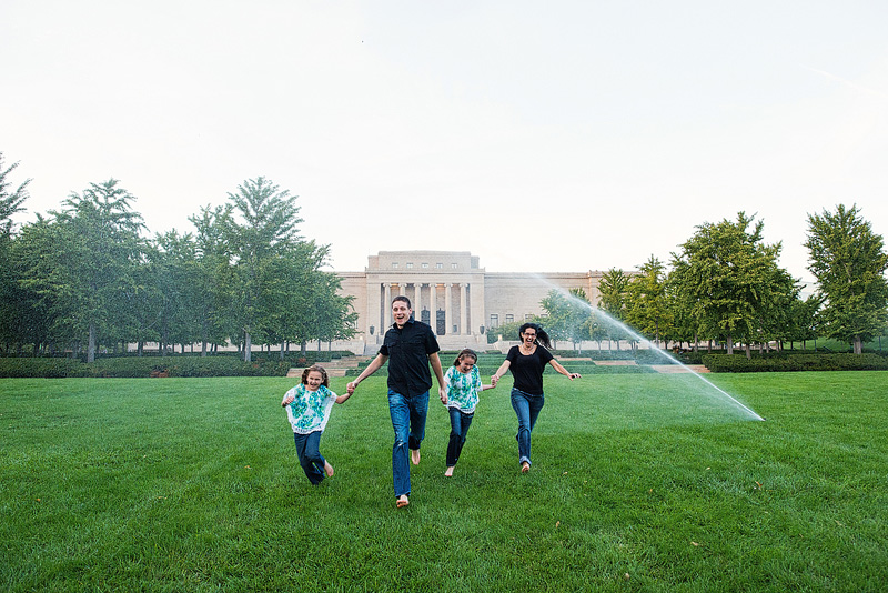 Kansas City photography of a family running outside the Nelson-Atkins Museum of Art.