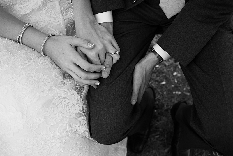 Bride and groom holding hands on their wedding day.