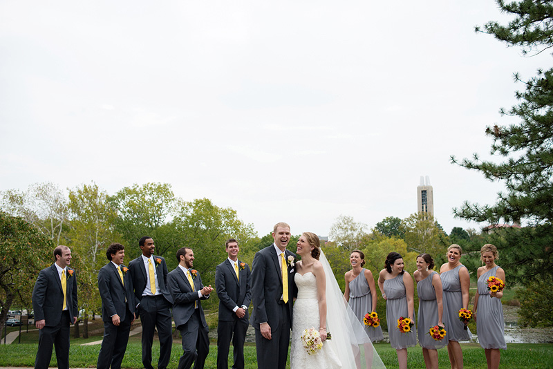 Laughing bridal party on KU campus.