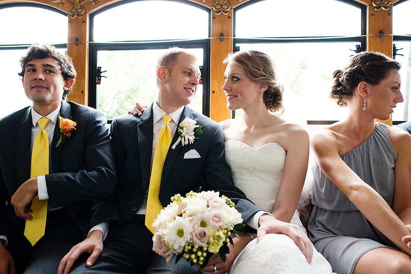Bride and groom on a trolley in Lawrence, Kansas.