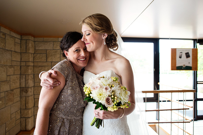 Bride hugging her mom in Lawrence Kansas on her wedding day.