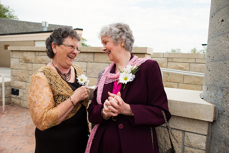 Grandmas laughing before a Lawrence, Kansas wedding.