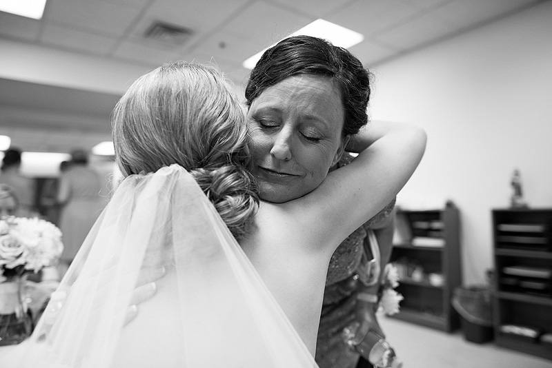 Mom hugs her daughter on a wedding day in Lawrence.