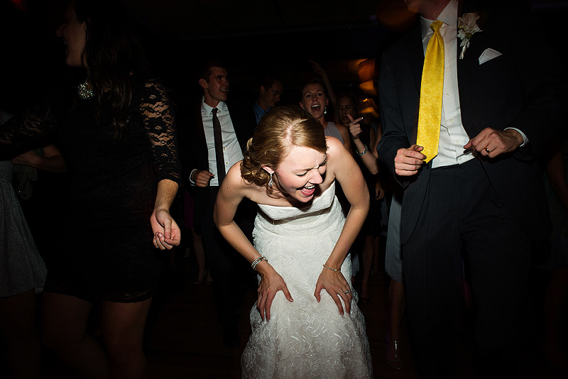 Bride laughing on the dancefloor.