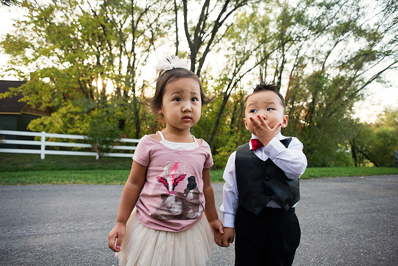 Little boy blowing kisses to a girl.